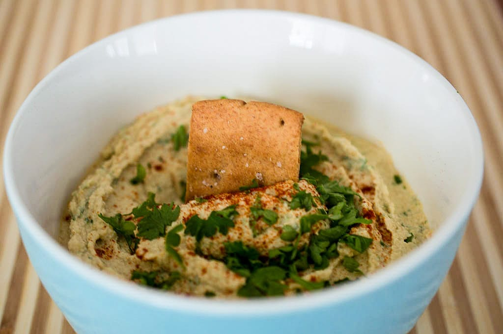 This easy roasted garlic and lemon hummus is less expensive and tastier than store bought.