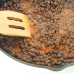 Mexican spiced black beans in a cast iron skillet