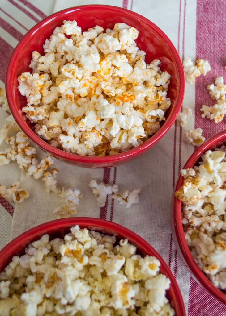 Three flavors of homemade microwave popcorn, a healthy, satisfying snack that has only 120 calories.