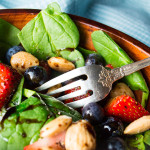 Spinach salad with berries, almonds and balsamic glaze
