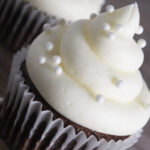 vanilla buttercream frosting on a chocolate cupcake