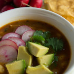 Easy red posole for the pressure cooker or crock pot is tasty plain or topped with radishes, avocado or cilantro.