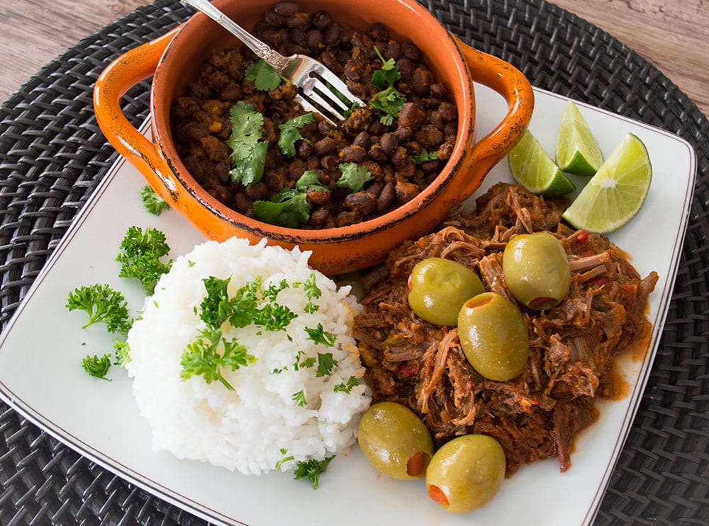 This budget Ropa Vieja recipe uses rump roast rather than the usual flank steak and cooks to tender perfection in the crock-pot.