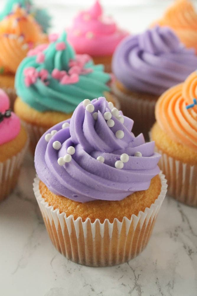 How to make bakery style cupcakes, the easy way! With a few tips and tricks, you can bake and pipe your best cupcakes ever.