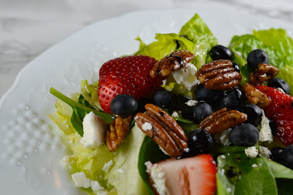 spinach salad with berries, feta cheese, spiced pecans and balsamic dressing