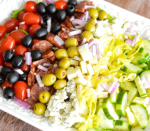 This Chopped Antipasti Salad is a copycat of the popular dish at Buca di Beppo. It's loaded with veggies, cheeses, olives and salami.