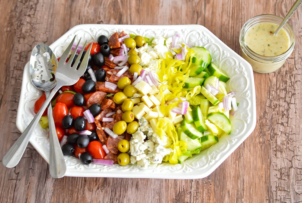 This Buca di Beppo copycat Chopped Antipasti Salad is loaded with yummy veggies, cheeses, salami and olives.