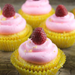Lemon cupcakes filled with raspberry jam and topped with raspberry buttercream - a perfect summertime dessert!
