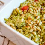 Pesto rice with chicken, tomatoes and pine nuts