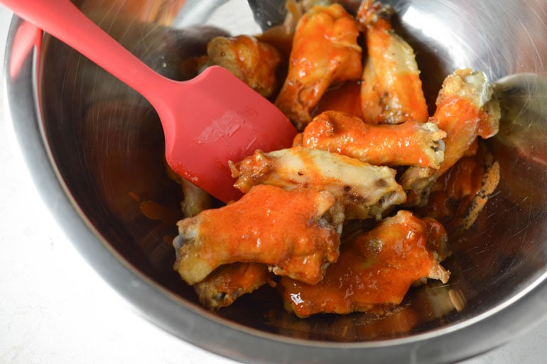 Baked wings are covered in spicy, amazing Buffalo Sauce.