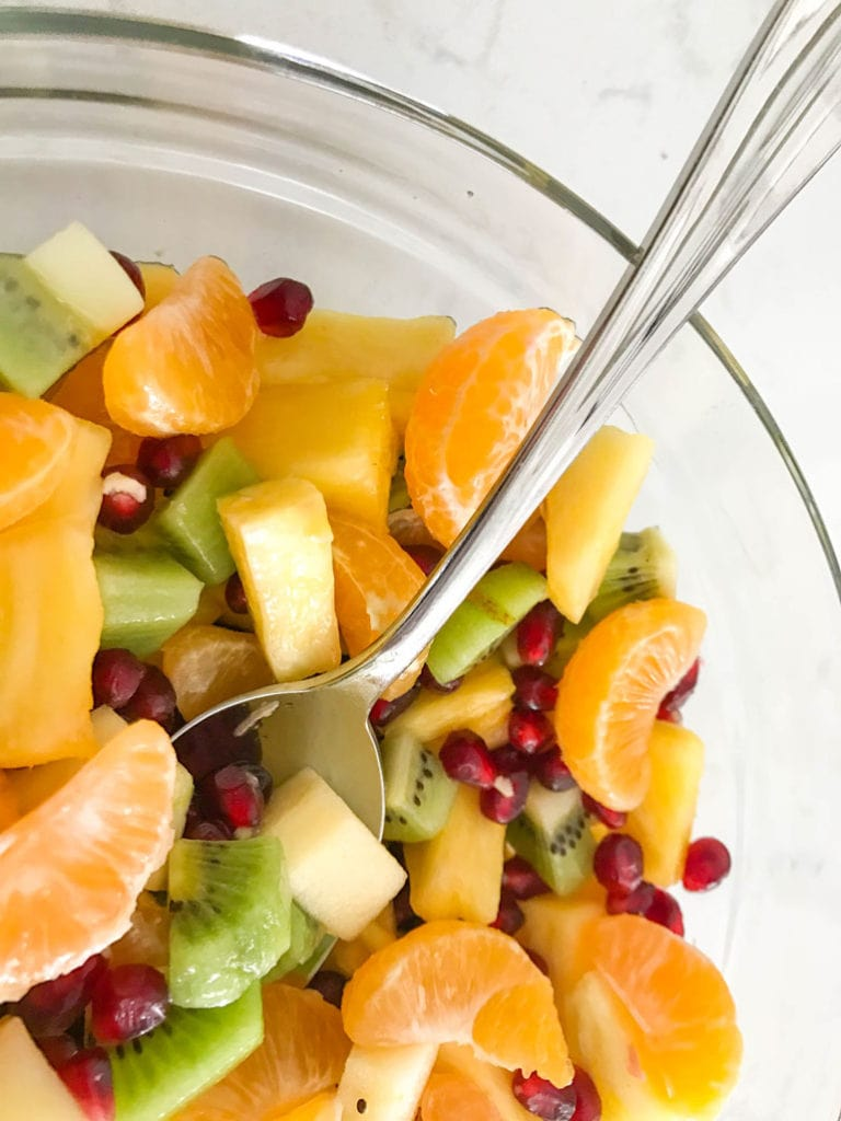This beautiful winter fruit salad combines seasonal citrus, pineapple, pomegranate, kiwi and apples with a simple honey-lemon dressing.