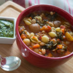 Winter minestrone with sausage, kale, and basil pistou is guaranteed to become one of your family's favorite soups!