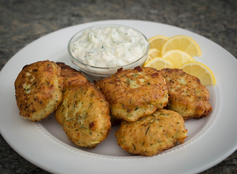 Greek zucchini balls or zucchini fritters take humble ingredients to a whole new level. Crisp on the outside, fluffy on the inside, and flavored with salty feta and fresh mint, Greek zucchini balls will be your new favorite party appetizer!