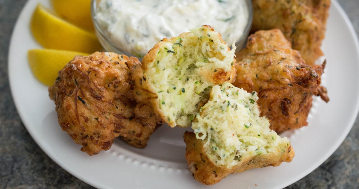 Greek zucchini balls are crisp on the outside, soft and fluffy on the inside, flavored with salty feta and fresh mint. A perfect appetizer for summer or any time of year!