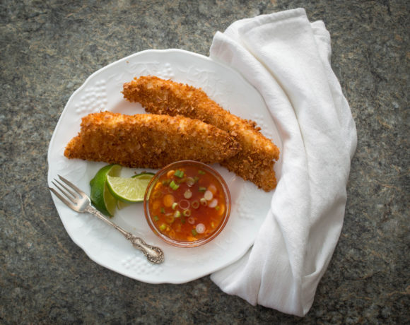 Coconut tilapia brings mild tilapia filets to a new flavor level, with a crunchy crumb coating, a sweet an spicy dipping sauce and a kick of lime.