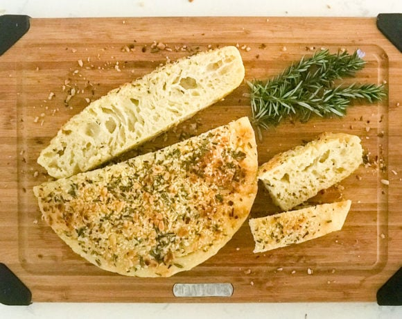 No knead skillet focaccia is light but chewy, with a perfect, airy texture. Topped with rosemary and pine nuts.