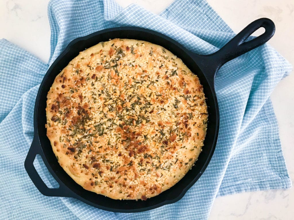 This gorgeous no knead skillet focaccia takes only 15 minutes of prep time. Topped with rosemary and pine nuts.