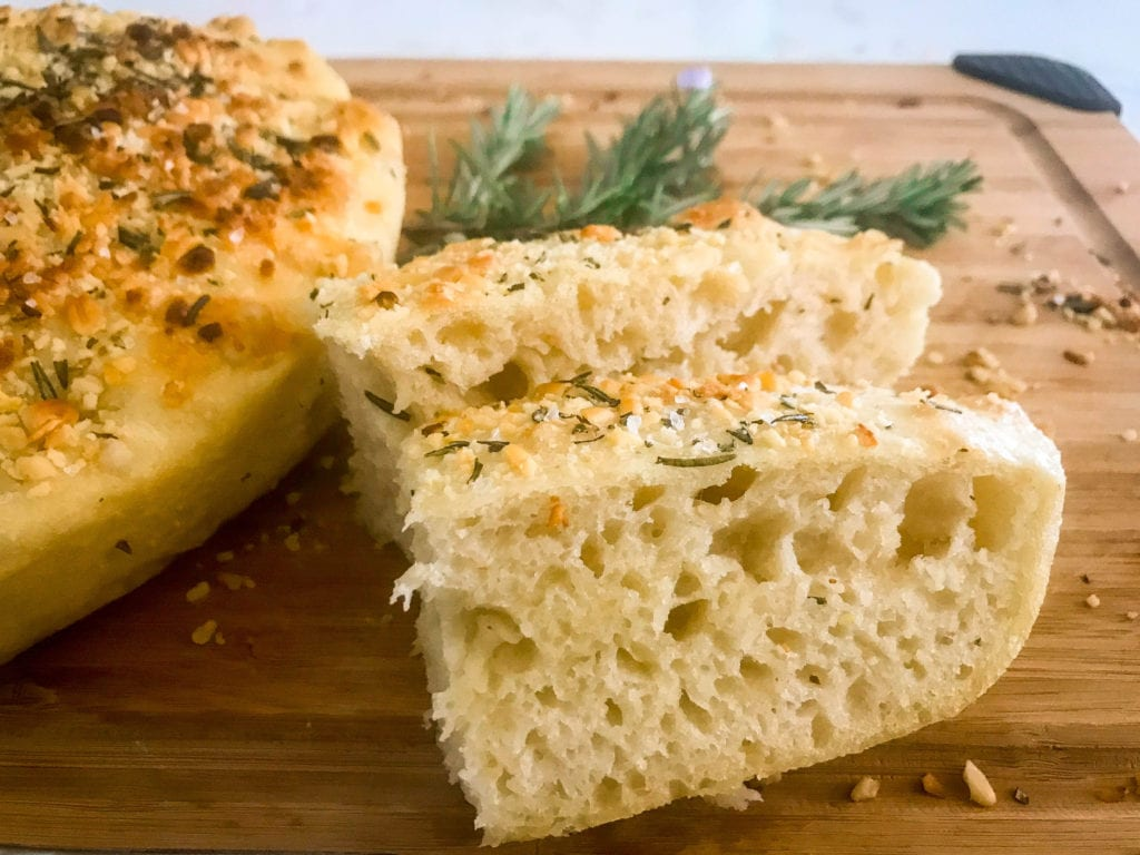 No knead skillet focaccia has a perfect, crispy crust and an airy but chewy texture. Topped with fresh rosemary and toasted pine nuts.