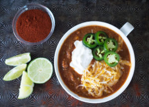 Cook up the best chili of your life with the Instant Pot! Beef, bacon, fresh veggies, warm spices, and a surprising secret ingredient give this Instant Pot beef chili its knockout flavor.