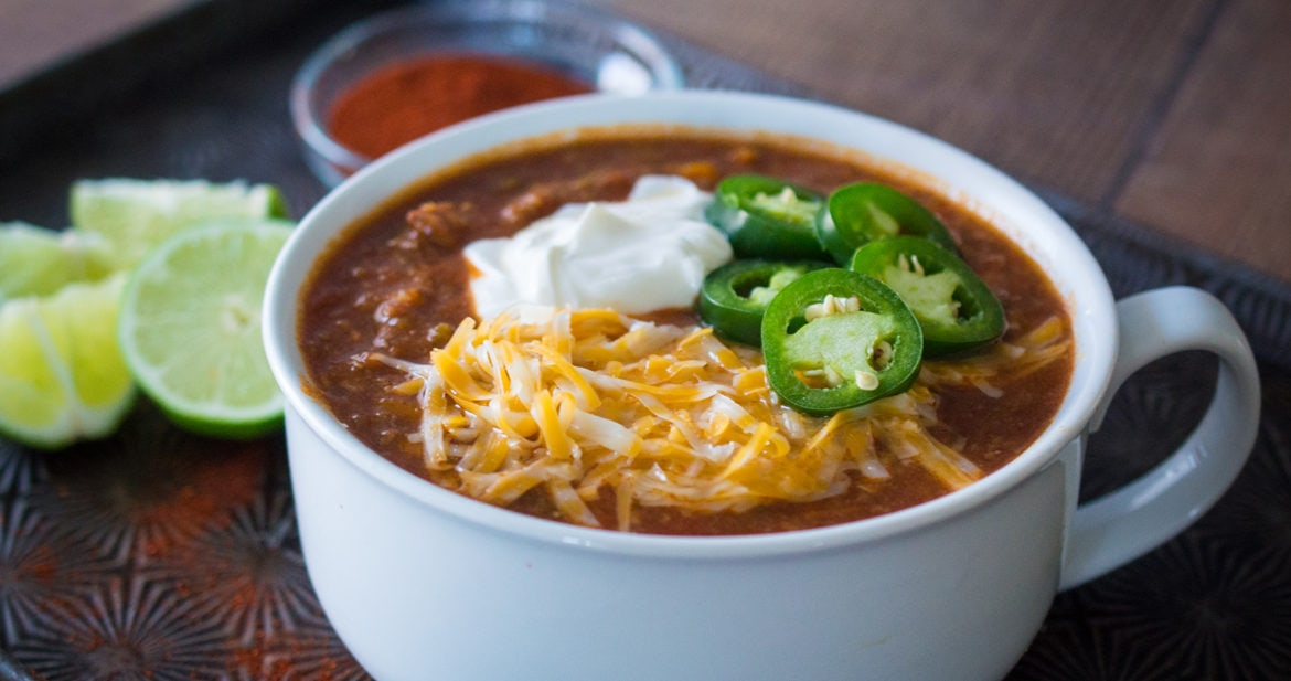 Instant pot beef chili with bacon and jalapeño will knock your socks off with its rich, complex flavor.