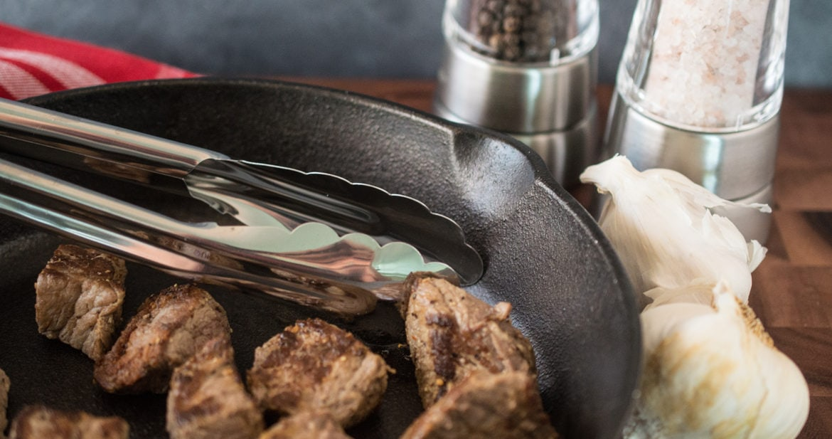 Steak bites cooked in a cast iron skillet