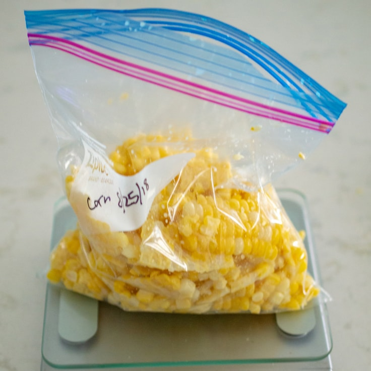 Corn kernels being bagged for the freezer