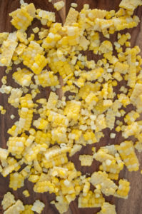 Fresh corn kernels on a cutting board