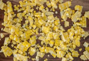 Fresh corn kernels on a cutting board