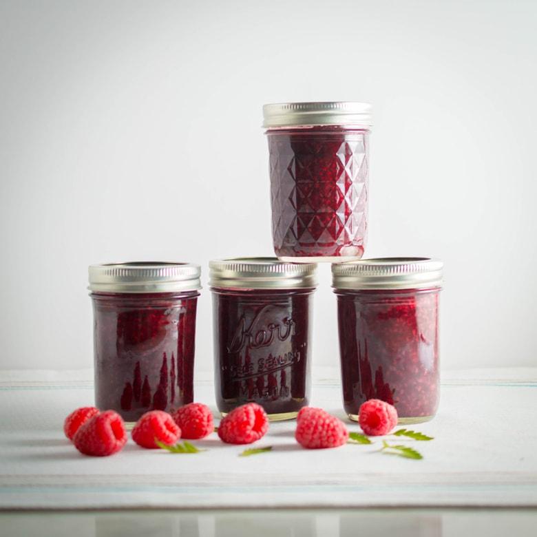 stacked jars of homemade low sugar raspberry jam