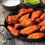 baked buffalo wings served with carrots, celery and blue cheese dip
