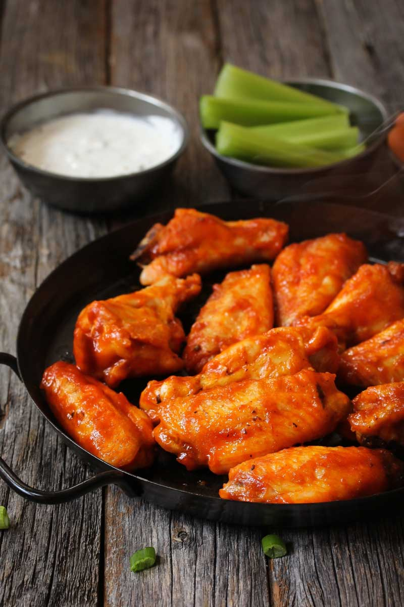baked buffalo wings served with celery and blue cheese dip