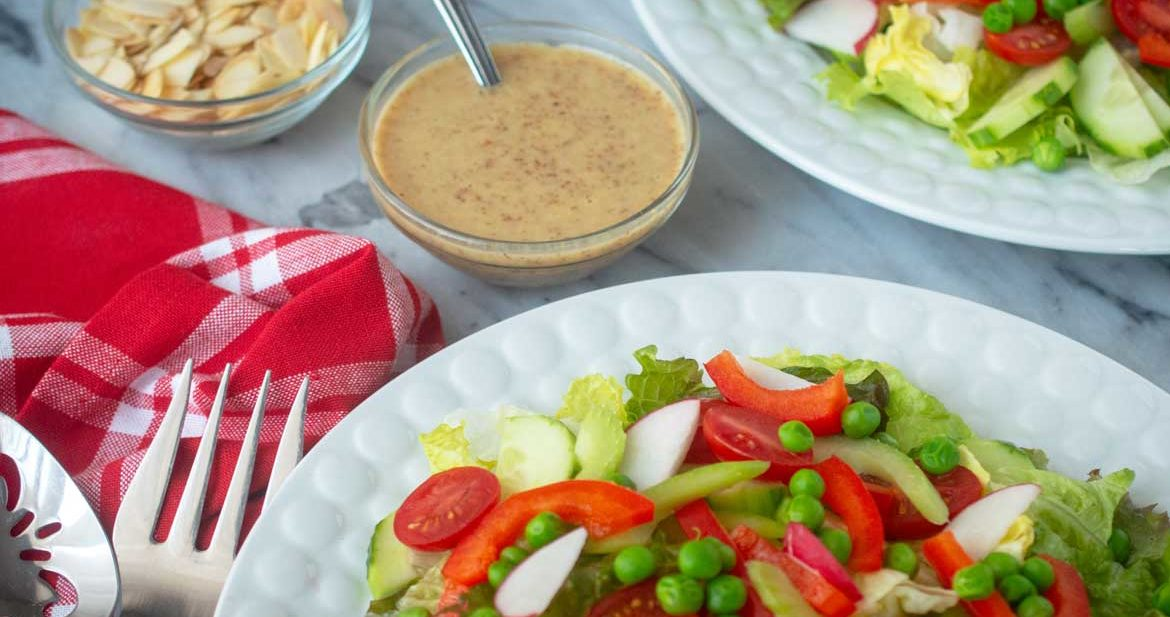 red and green tossed salad with honey mustard dressing and sliced almonds