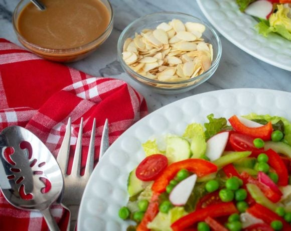 red and green tossed salad with sesame ginger dressing