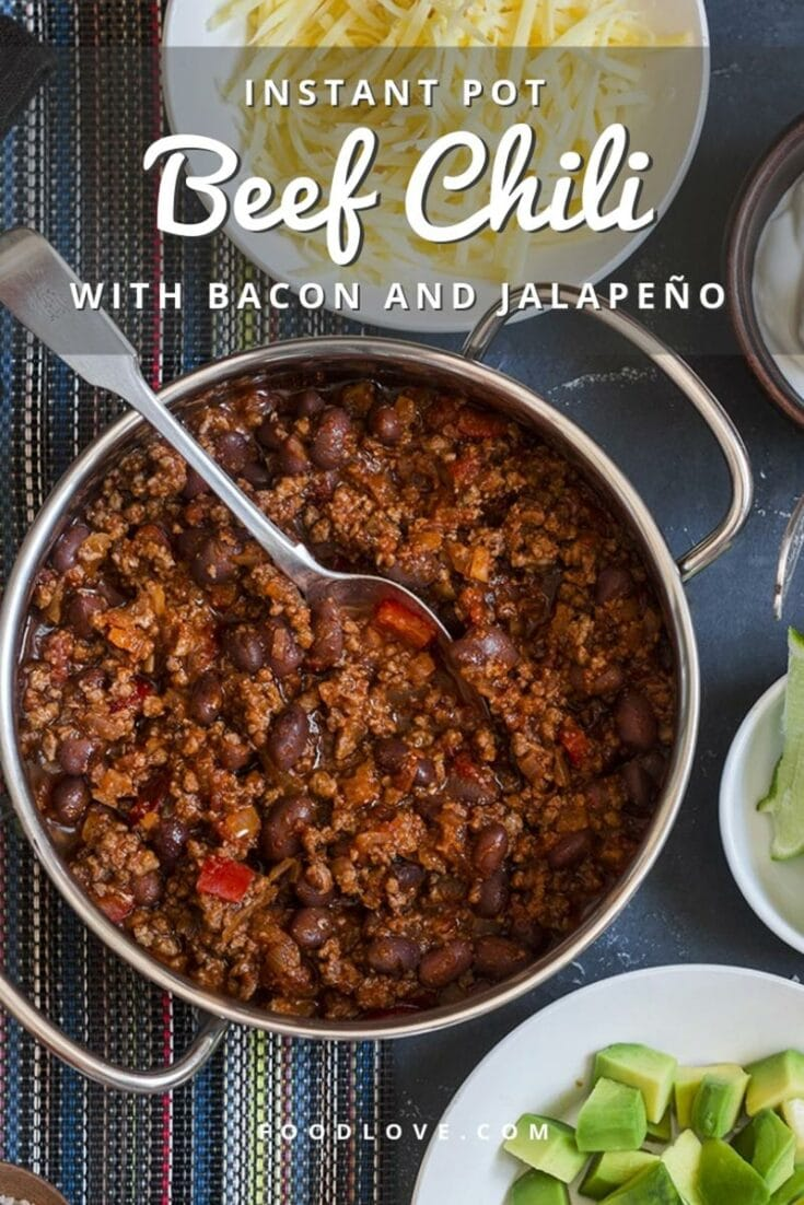Make the best beef chili ever with the Instant Pot electric pressure cooker! This medium spicy chili gets its knockout flavor from tender chunks of beef, a touch of smoky bacon, fresh vegetables, warm, aromatic spices, and a surprising secret ingredient. #chili #instantpot #beefrecipes #comfortfood #spicy