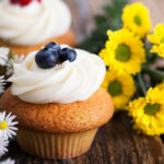 cupcakes with berries and spring flowers