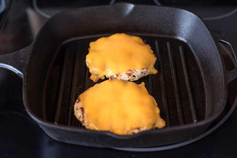 seasoned turkey burgers in a grill pan