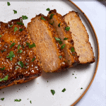 pinterest button of sliced chicken meatloaf with parsley