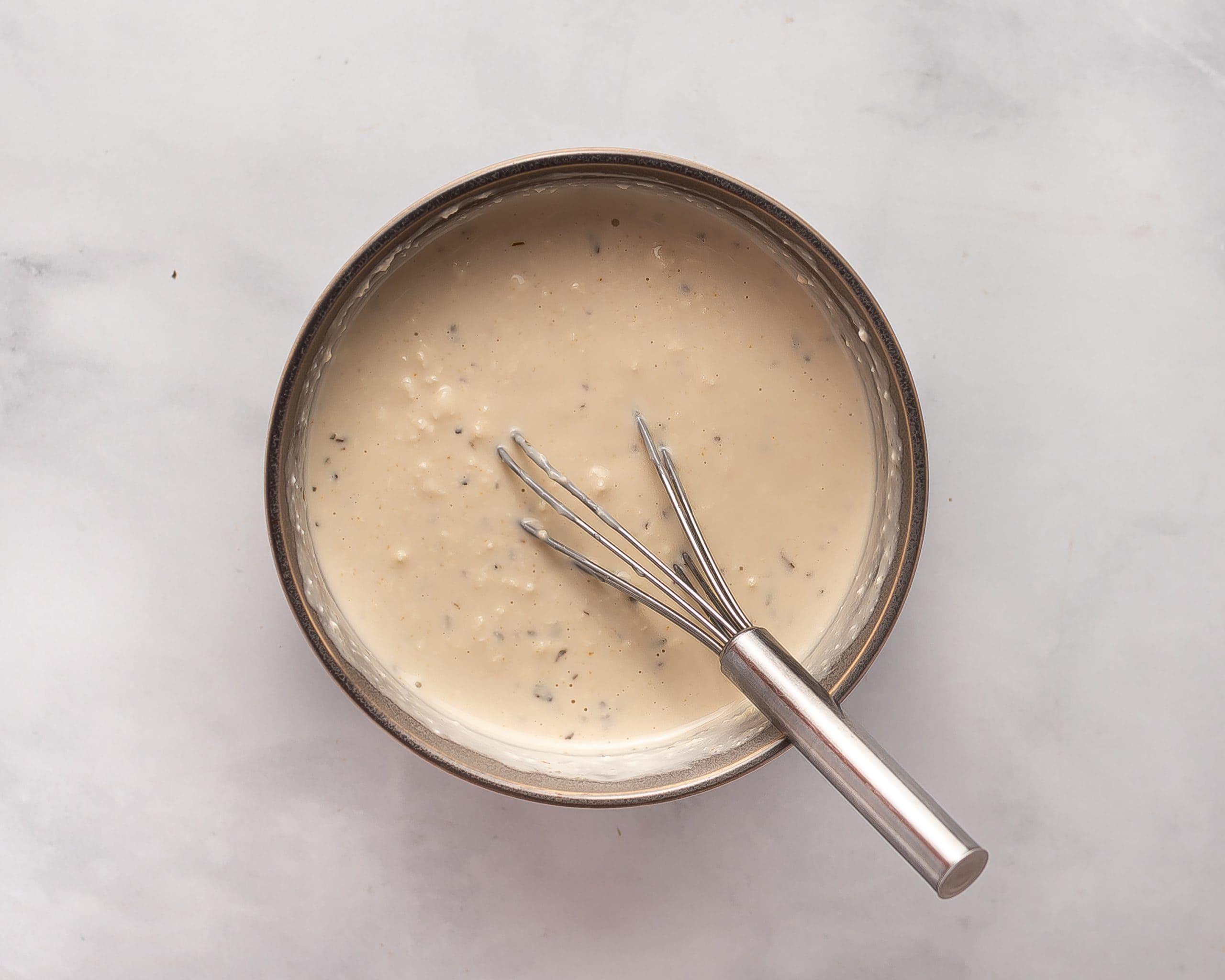 bowl with Prepared vegan blue cheese dip for seitan wings