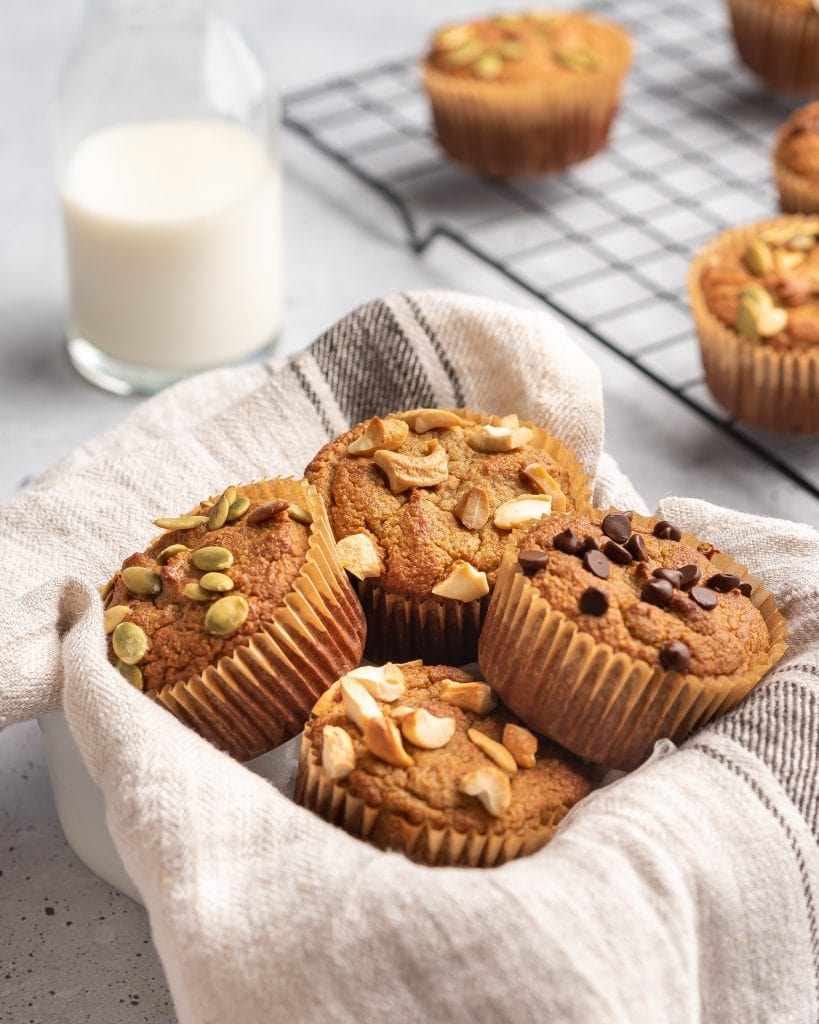 basket with a towel filled with almond flour muffins