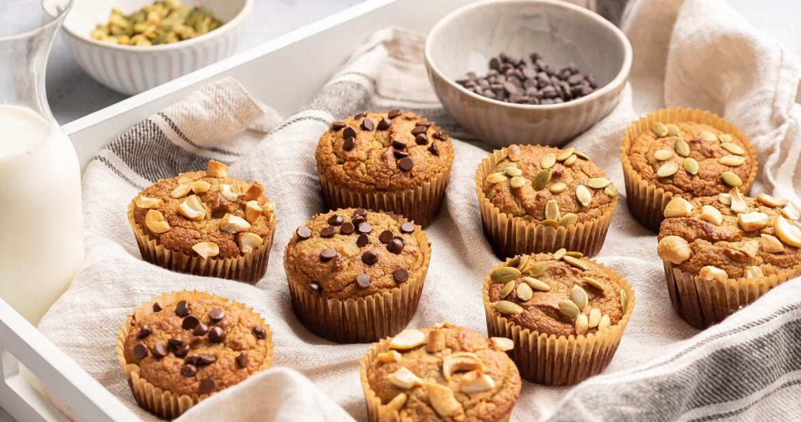 tray of almond flour muffins with chocolate chips and nuts
