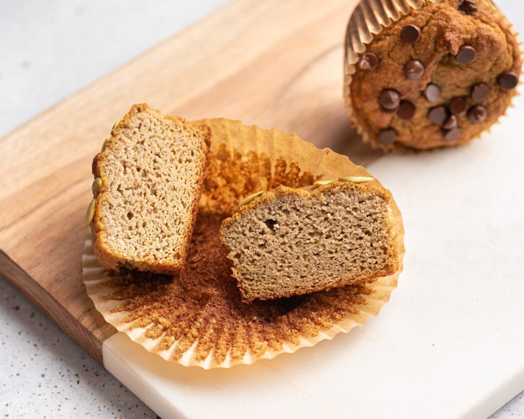 sliced in half almond flour muffin on a paper liner