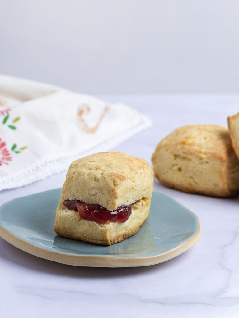 biscuit with homemade raspberry jam on a green palte