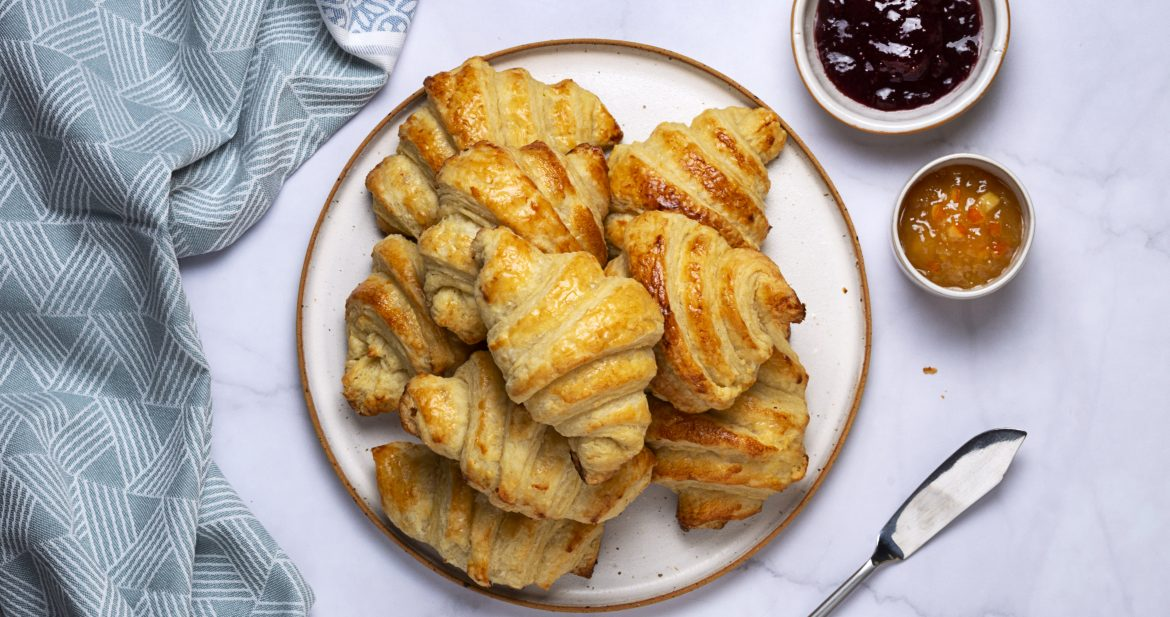plate of vegan croissants with jam on the side