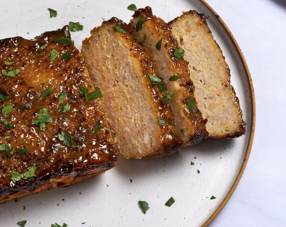 chicken meatloaf sliced into three pieces on a white plate