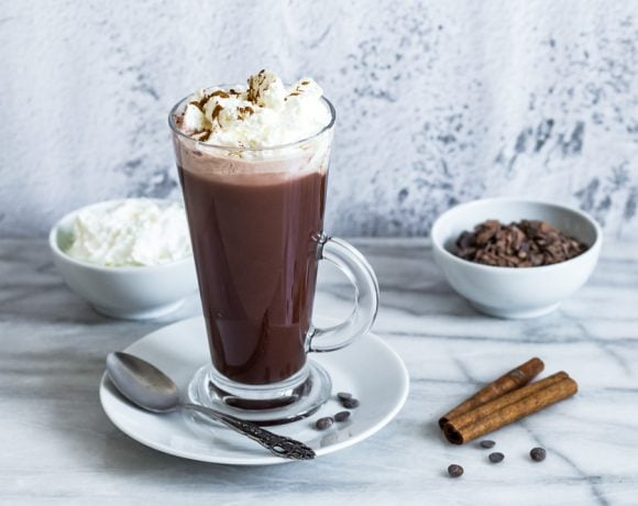 vegan hot chocolate with whipped cream and cinnamon on top
