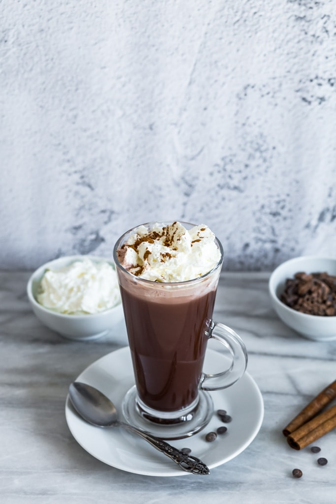 glass of vegan hot chocolate with whipped cream