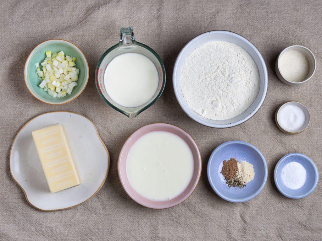 "ingredients for vegan biscuits"" flour, baking soda, sugar, vegan butter, and seasonings for gravy"