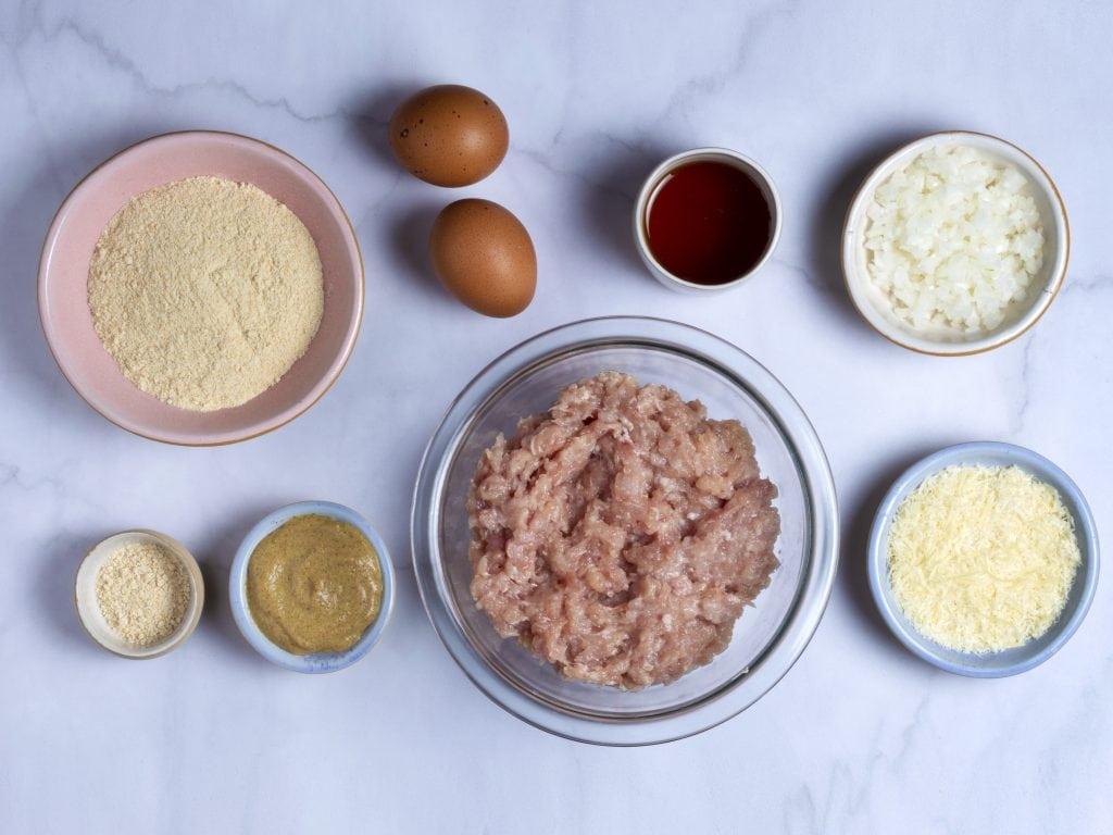 ingredients for easy chicken meatloaf: ground chicken, eggs, parmesan, breadcrumbs, salt and pepper