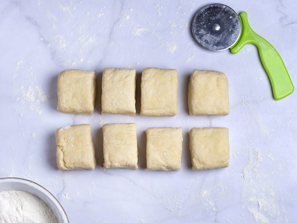 shaped vegan biscuits on a marble pastry board