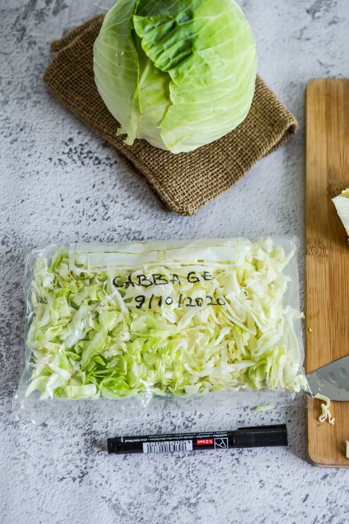clear plastic bag of fresh shredded cabbage to be frozen
